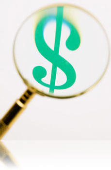 Magnifying glass over money, Fishbowl Inventory Blog