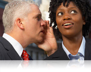 Whispering in a businesswoman's ear, Fishbowl Inventory Blog