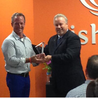 Fishbowl CEO David K. Williams accepts an award from Principal for its focus on its employees' fiscal health, Fishbowl Blog