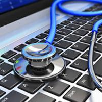 stethoscope and laptop keyboard